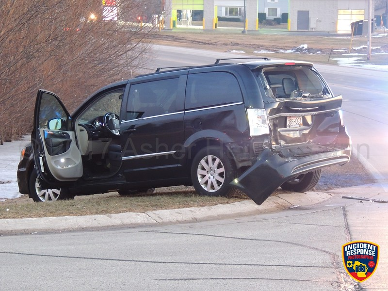 Hit-and-run accident on Main Street at Crocker Street in Sheboygan Falls, Wisconsin on Monday, February 27, 2017. Photo by Asher Heimermann/Incident Response.