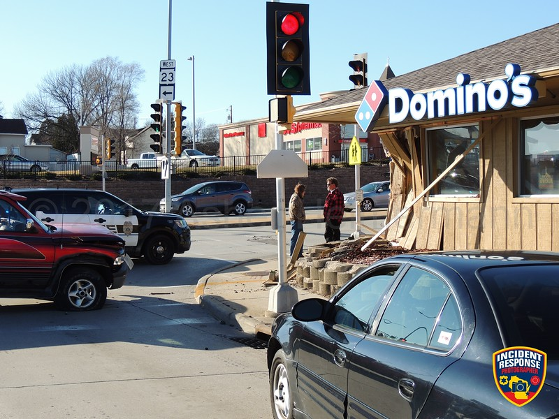 A pick-up truck crashed into Domino's Pizza at North 14th Street & Erie Avenue on Wednesday, March 8, 2017. Photo by Asher Heimermann/Incident Response.