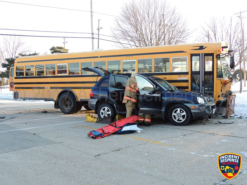 Two vehicle accident with injuries involving a school bus at South 12th Street and Humboldt Avenue in Sheboygan, Wisconsin on Wednesday, March 15, 2017. Photo by Asher Heimermann/Incident Response.