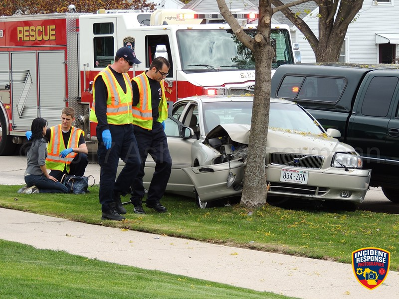 Car vs. tree accident at South 16th Street & Humboldt Avenue in Sheboygan, Wisconsin on Saturday, May 13, 2017. Photo by Asher Heimermann/Incident Response.