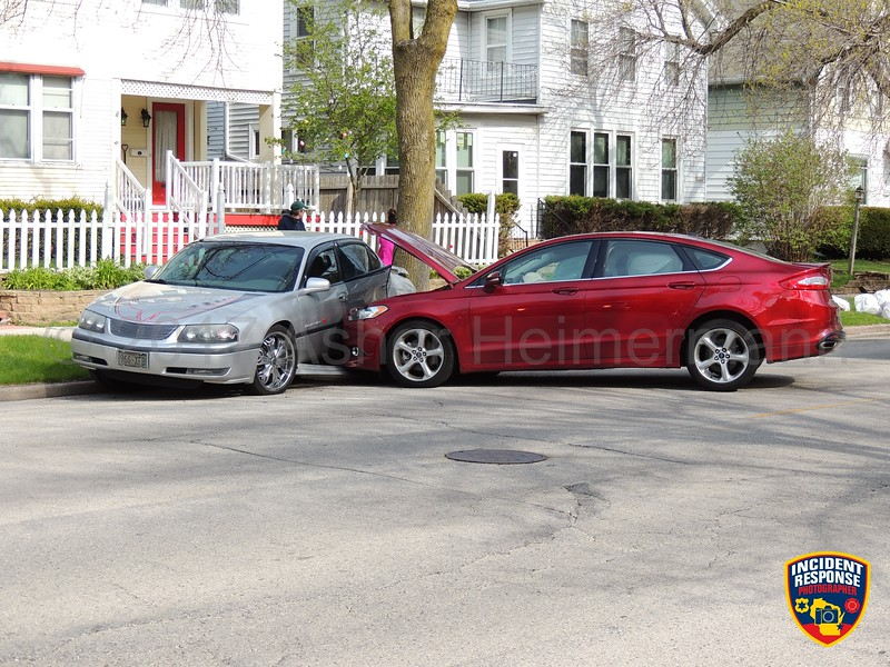 A car crashed into a parked car on North 7th Street in Sheboygan, Wisconsin on Monday, May 15, 2017. Photo by Asher Heimermann/Incident Response.