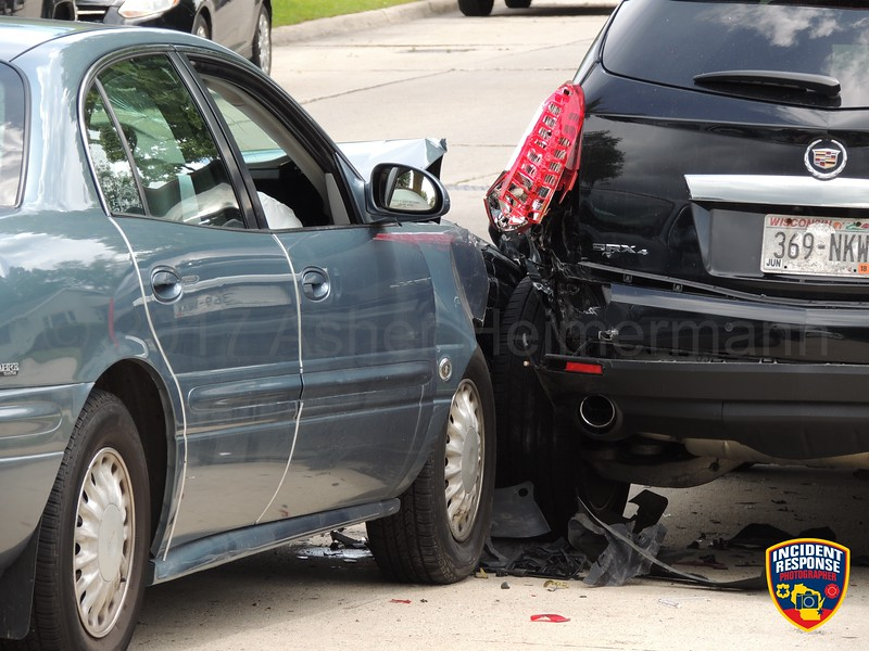 Car vs. parked vehicle accident in the 1900 block of Mead Avenue in Sheboygan, Wisconsin on Monday, June 19, 2017. Photo by Asher Heimermann/Incident Response.
