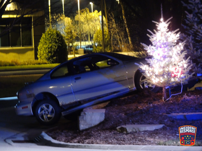A car collided with a boulder at the entrance of Sargento at County Road C & Persnicktety Place in Plymouth, Wisconsin on Sunday, December 3, 2017. Photo by Asher Heimermann/Incident Response.