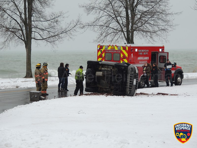 Single vehicle rollover accident on Broughton Drive near North Point Park in Sheboygan, Wisconsin on Tuesday, March 6, 2018. Photo by Asher Heimermann/Incident Response.