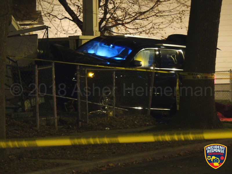 Two-vehicle crash involving a house at South 20th Street & West Mineral Street in Milwaukee, Wisconsin on Wednesday, December 5, 2018. Photo by Asher Heimermann/Incident Response.