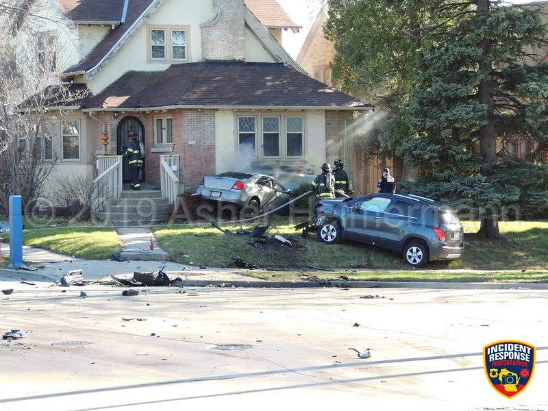 Milwaukee Police were in pursuit of a reckless car on Saturday, April 20, 2019 when it crashed into another vehicle and into a home at North 13th Street and Capitol Drive. The driver was killed at the scene. Photo by Asher Heimermann/Incident Response.