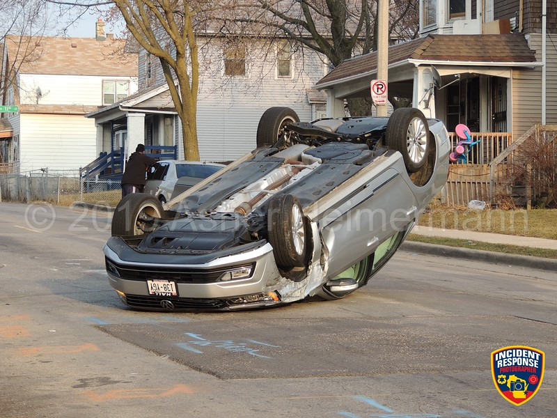One person was injured in a rollover accident at North 12th Street and West Keefe Avenue in Milwaukee, Wisconsin on Saturday, April 6, 2019. Photo by Asher Heimermann/Incident Response.