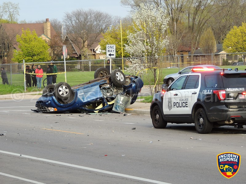 Two people were arrested after a Milwaukee Police pursuit ended with a rollover crash at West Center Street and North 44th Street in Milwaukee, Wisconsin on Saturday, May 11, 2019. Minor injuries were reported. Photo by Asher Heimermann/Incident Response.