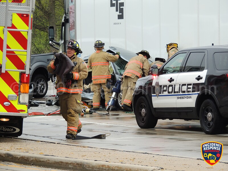 Sheboygan firefighters worked to free a woman trapped in her car on Friday, May 24, 2019 after a multi-vehicle crash involving a semi at South Taylor Drive and Indiana Avenue. Photo by Asher Heimermann/Incident Response.