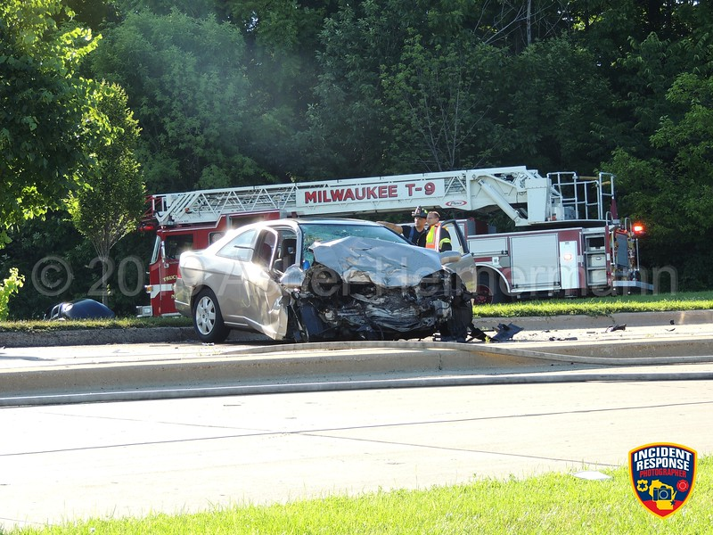 Firefighters from Milwaukee and Wauwatosa responded to a two-vehicle rollover crash at North Hawley Road and West Martin Drive on Wednesday, July 3, 2019 in Milwaukee, Wisconsin. At least two people were reportedly trapped. Photo by Asher Heimermann/Incident Response.