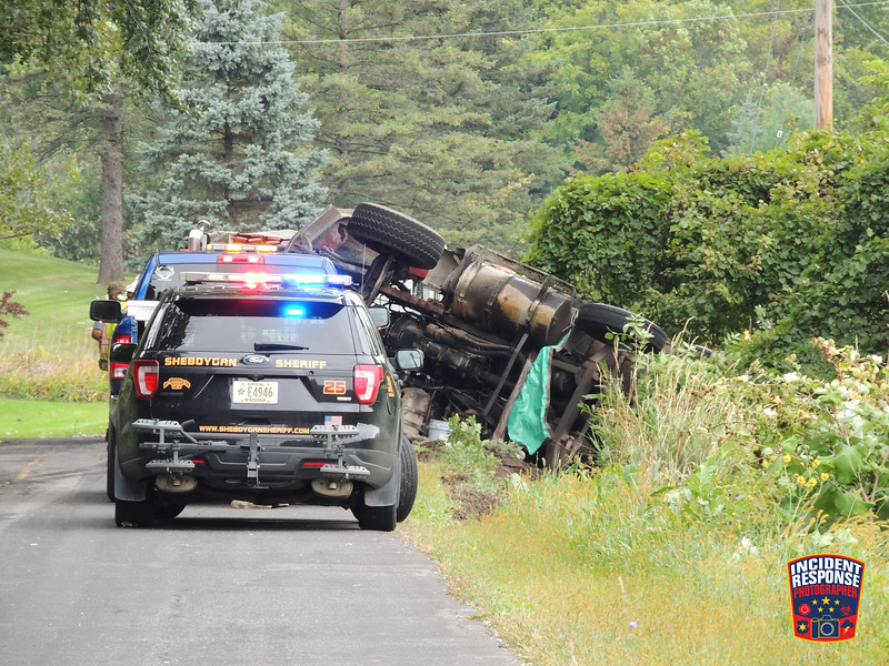 Fire departments from the Town of Sheboygan Falls and Johnsonville responded to a dump truck rollover accident on Tuesday, September 10, 2019 on Alpine Road between Highway 23 and County Road O. Photo by Asher Heimermann/Incident Response.