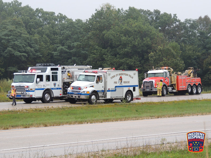 Firefighters responded to a concrete mixer truck rollover accident on Highway 23 near County Road TT in the Town of Sheboygan Falls, Wisconsin on Wednesday, September 11, 2019. A pick-up truck pulling a mini-excavator was also involved. Photo by Asher Heimernann/Incident Response.