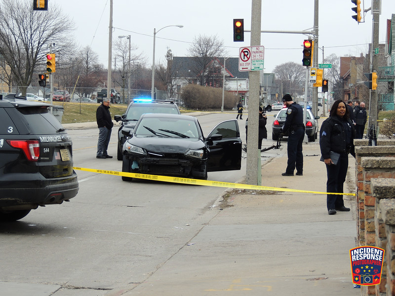 Milwaukee Police arrested a 36-year-old woman after leading officers on a brief chase on Friday, March 27, 2020. She ran a red light and hit another car at North 35th Street & Center Street. Police located a gun in the suspect's car. A 26-year-old Milwaukee man was injured in the crash. Photo by Asher Heimermann/Incident Response.