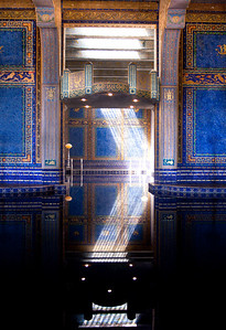 I was lucky to be on a tour which passed through at the right time to catch this beam of light reflecting into the Roman Pool at Hearst Castle.