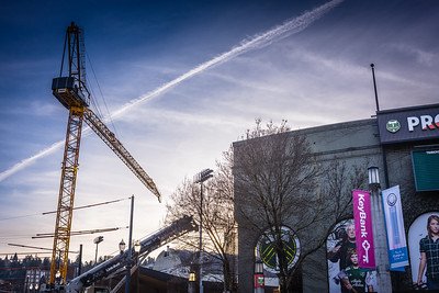 The crane for construction of the new east stand at Providence Park at sunset.