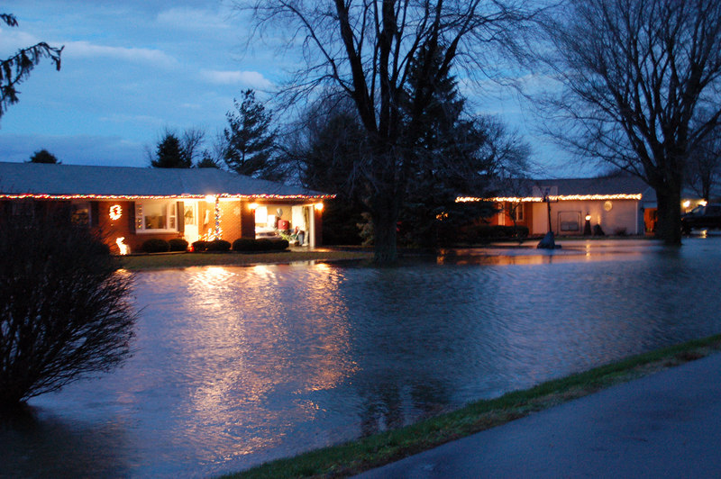 These folks almost had a very un-merry Christmas.   We've had an exceptionally warm winter with lots of rain.   The flooding came withing about two feet of the front door of the house on the right.