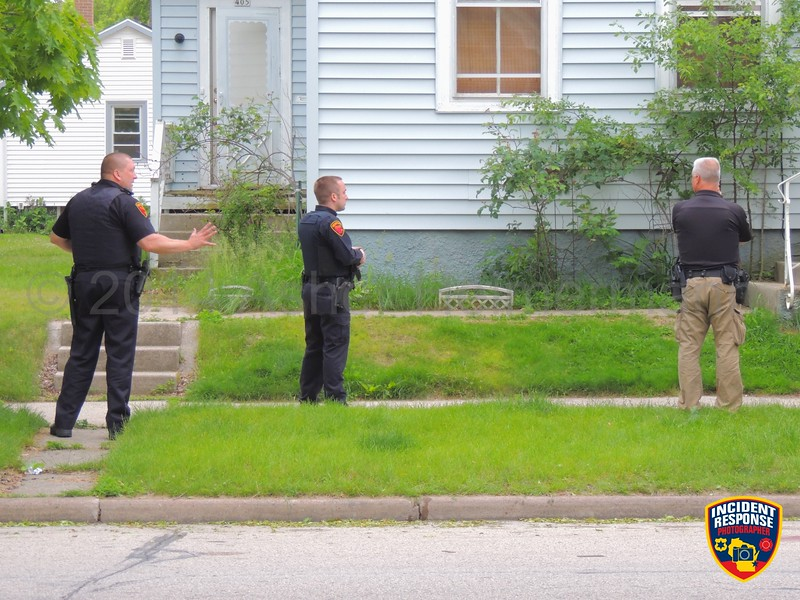 A Sheboygan Police Officer shot a pit bull that charged at him in the area of North 4th Street & Superior Avenue in Sheboygan, Wisconsin on Wednesday, June 25, 2014. Photo by Asher Heimermann/Incident Response.