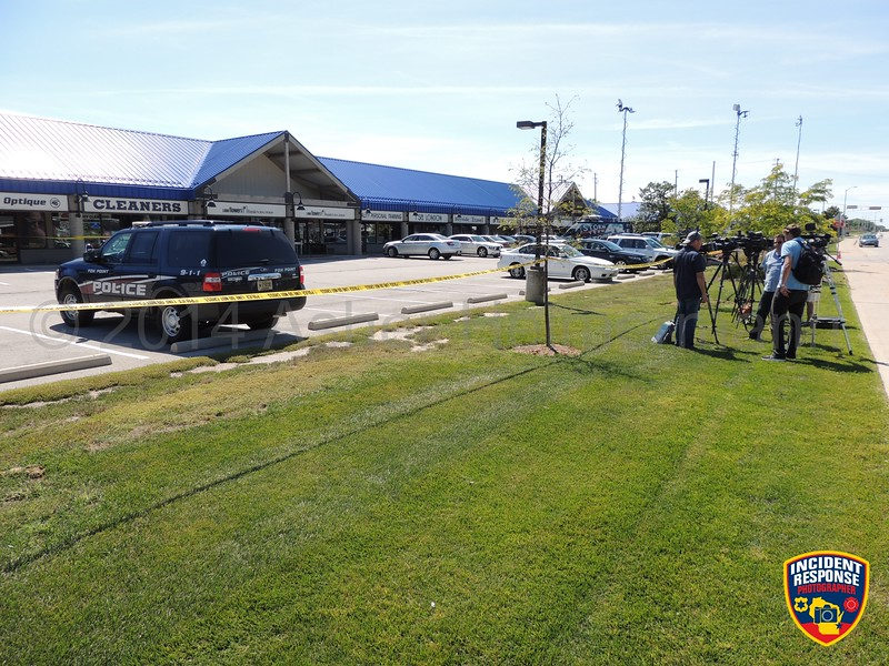 Multiple law enforcement agencies investigated a fatal shooting after an attempted robbery at 333 West Brown Deer Road in Bayside, Wisconsin on Thursday, August 14, 2014. Photo by Asher Heimermann/Incident Response.