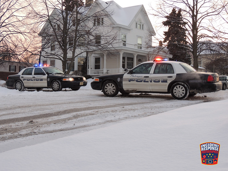 Sheboygan Police arrest a woman for allegedly waving a gun in the 400 block of Ontario Avenue in Sheboygan, Wisconsin on Saturday, February 1, 2014. Photo by Asher Heimermann/Incident Response.