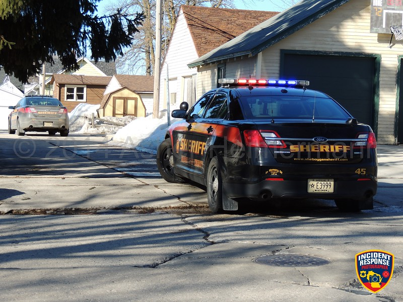 Law enforcement officers surrounded a home near South 16th Street & Union Avenue in Sheboygan, Wisconsin on Wednesday, March 12, 2014. Photo by Asher Heimermann/Incident Response.
