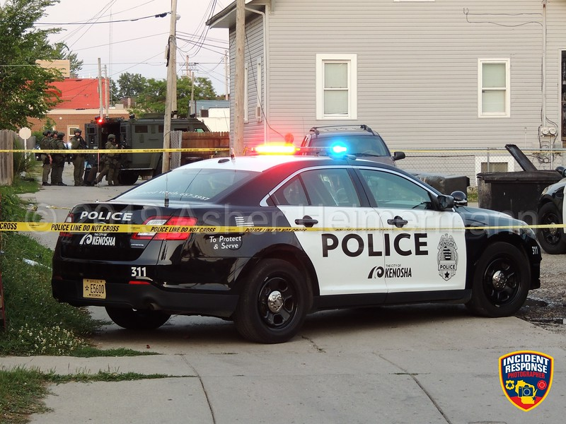 Police surrounded a home near 52nd Street & 23rd Avenue in Kenosha, Wisconsin on Tuesday, August 7, 2019. The Kenosha County Tactical Response Team was ordering a wanted man out of the house. When police entered the home hours later, the man was no where to be found. Photo by Asher Heimermann/Incident Response.