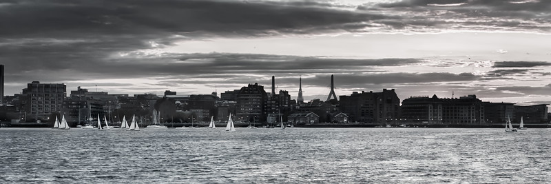 Sailboats racing on Boston Harbor with Zakim and Old North Church behind