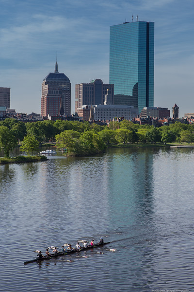 Crew rowing on the Charles River with Boston's Back Bay as a backdrop