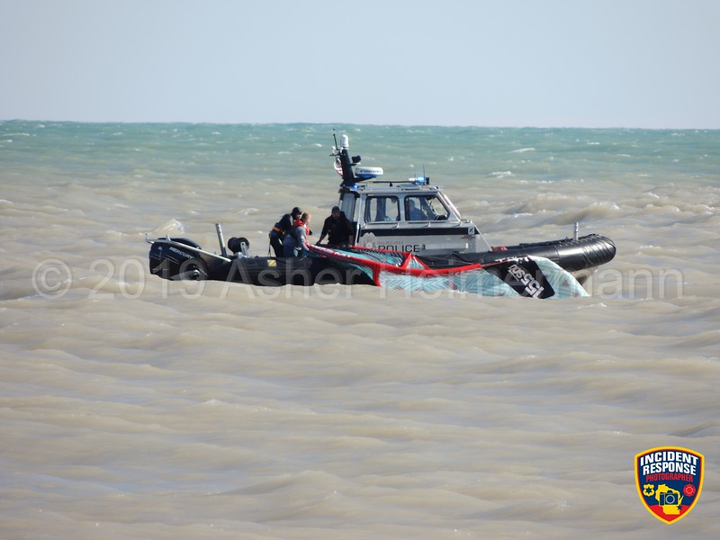 A kitesurfer in distress was rescued from Lake Michigan by the Milwaukee Police Harbor Patrol near McKinley Marina on Thursday, April 19, 2019. Photo by Asher Heimermann/Incident Response.