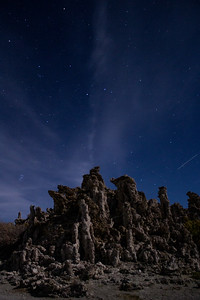 Clouds and a satellite in the night sky at South Tufa.