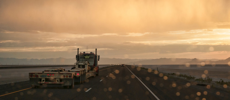 "The Long Drive Into the Sunset...<br /> <br /> A long but short trip from Chico, CA to Denver, CO and back again...to get my son and his stuff...two days there and one back.  Storms and the sunset while crossing the salt flats...all while being passed by the ""TRAIL KING""..."