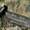 "Taken August 14, 2004. The ""Ain't Finished Yet Trail"" is the trail to Cougar Rock off Morgan Territory Rd. This trail head sign was removed in 2006."