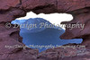 Pikes Peak through hole in Siamese Twin at Garden of the Gods Park, Colorado Springs, Colorado