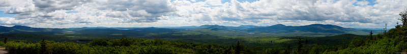 This panorama was taken from the summit of Quill Hill in Dallas Plantation, Maine. Saddleback Mountain is located on the far left and the view moves across the valley to East Kennebago Mountain on the right. The image measures 20 inches high by 13-feet wide.