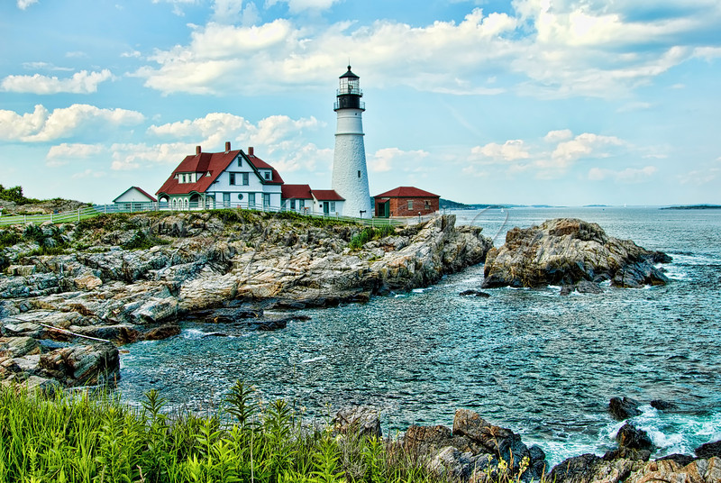 The Lighthouse at Portland Head.<br /> <br /> This very popular landmark is positioned along the spectacular shores adjacent to Fort Williams Park in the Town of Cape Elizabeth, Maine.