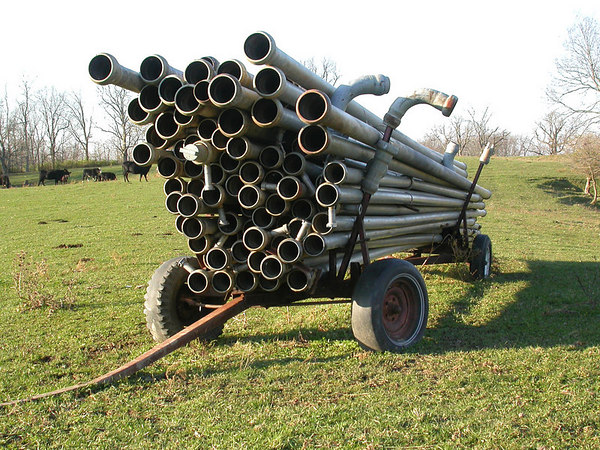 Irrigation pipes stored on trailer in a Kentucky pasture