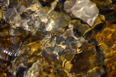 Stock image of light patterns in a crystal clear stream.  Photographed in the Lower Howards Creek Nature and Heritage Preserve in the Bluegrass region of Kentucky USA.