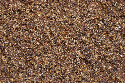 Stock image of texture and patterns in  coarse sand.  Photographed in the Lower Howards Creek Nature and Heritage Preserve in the Bluegrass region of Kentucky USA.