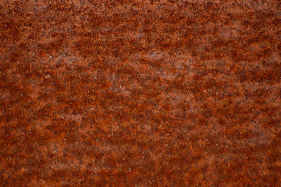 Stock image of texture and patterns in a rusty steel beam.  Photographed in the Lower Howards Creek Nature and Heritage Preserve in the Bluegrass region of Kentucky USA.