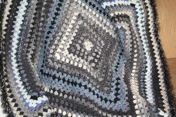 Blanket for New GS1, born May 9, 2009, nice soft grays and blues in wool, done up in a granny square motif.  I made it myself-Grandma Hat.