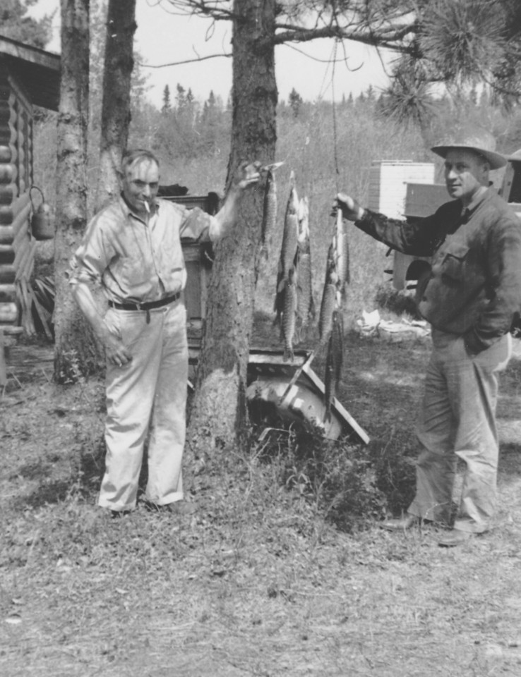 Grandpa Lou Killmer (left) and Jack Tasler (Osseo School Bus owner), taken at Russel's cabin, on Lake Inguadona, near LongVille, MN.  1940's or 1950's.