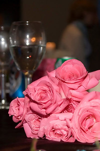 Pink roses and out of focus wine glasses
