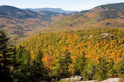 Hiking Bluebery Mountain, Maine along the Bickford Brook  and Blueberry Ridge Trails.  Views seen are looking West to New Hampshire and the White Mountains as the Fall Foliage shows it beautiful array of bright colors.  Hike was completed on 10.8.06