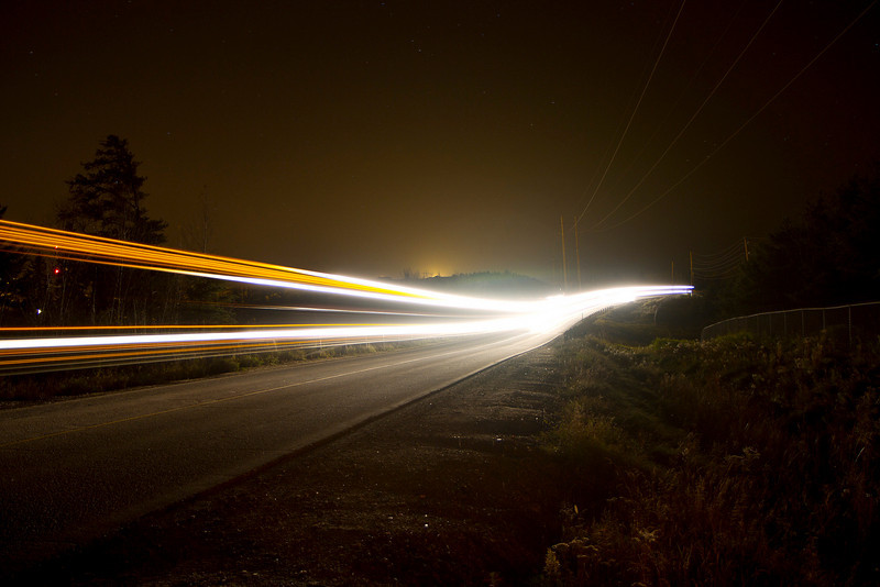 A 25 second exposure on a road behind the local mill. This was a woodchip truck going by on the road.