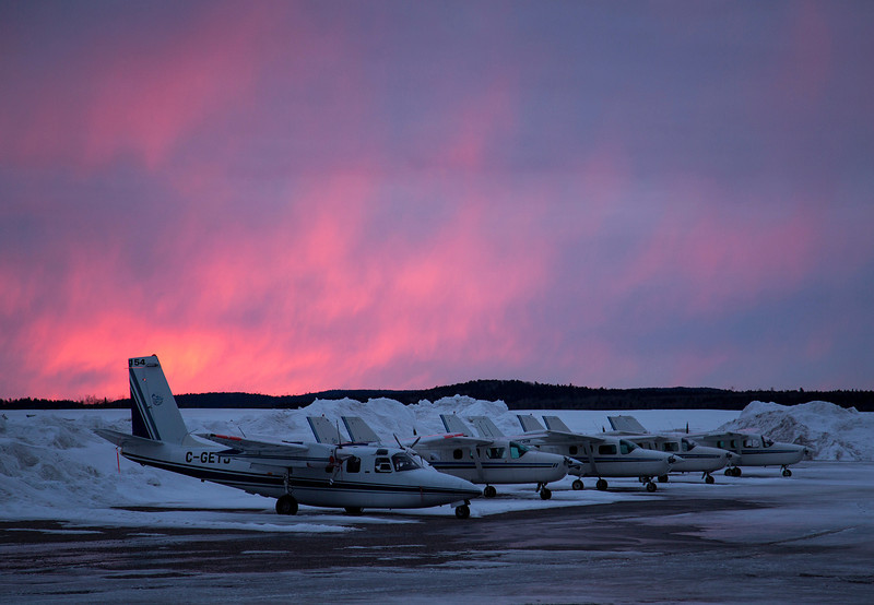 86 of 365 (Fire In the Sky)<br /> <br /> Several aircraft from Discovery Air Services sitting in the snow early in the morning.