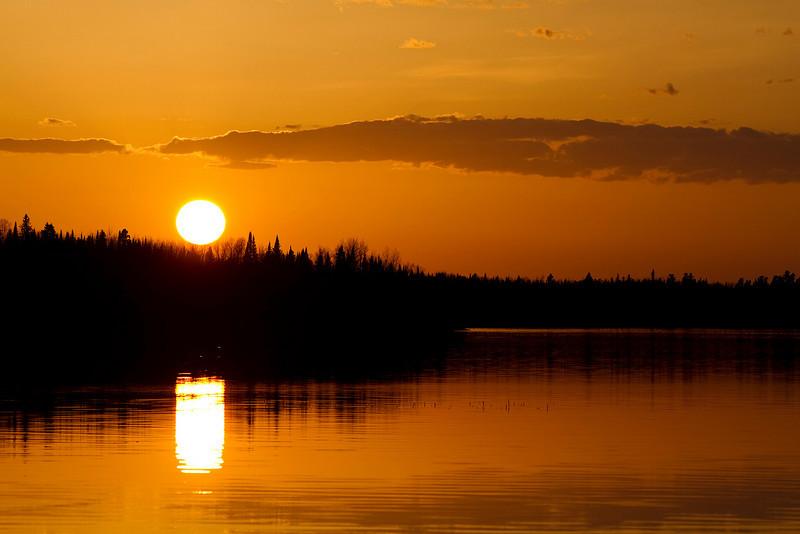 Sun setting over Thunder Lake. Taken at the beach of Aaron Park.