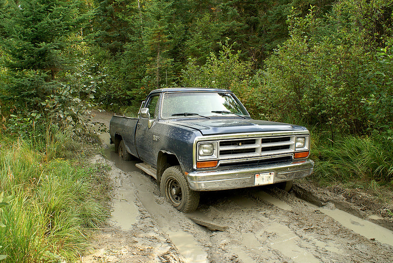 On my way out of Gullwing Lake, I didn't quite have the momentum I needed to get through this big mud puddle. <br /> <br /> I tried to use wood, rocks in the area (not many at this part of the road) - anything I could get under the wheels to try and get some grip. Nothing helped.<br /> <br /> At the end of February of 2008, we traded the ol girl in for a 2008 Jeep Liberty. I can't wait to see how the Jeep handles that mud puddle!!