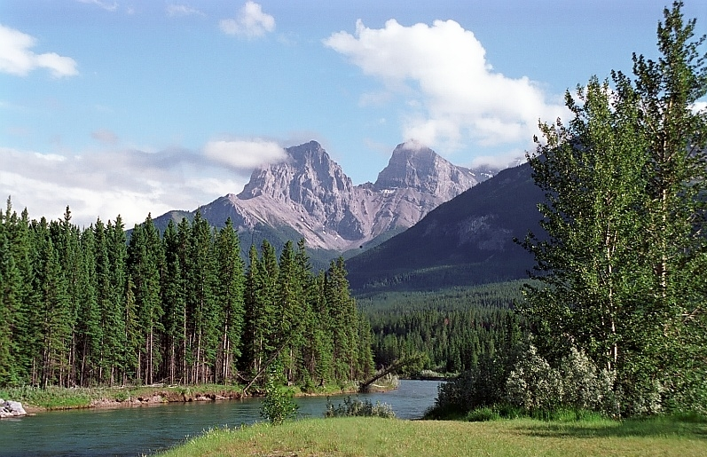 Taken with a film camera (Minolta 700si I believe) in Canmore Alberta. These mountains are called 'The Three Sisters'.