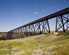 This CP Rail bridge - the High Level Bridge - is 5,327 feet long (or 1 mile and 47 feet), and 314 feet above the riverbed. It is located in Lethbridge, Alberta.<br /> <br /> I couldn't get all of the bridge in this photo - maybe 300 feet is still to the right of the cameras position. No trains running at the time of the photo which was too bad.<br /> <br /> We where here the evening before but a storm brewed up - including hail a little smaller than marbles.