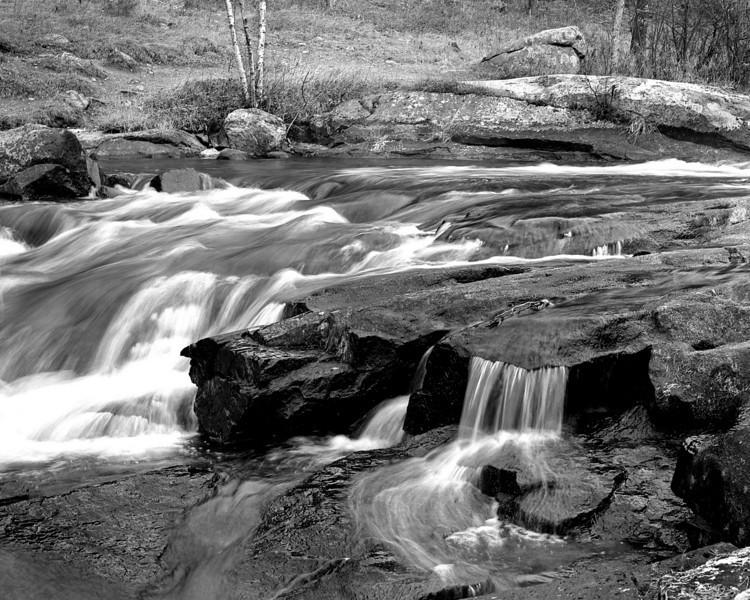 One of the first rolls of film through my Pentax 645N, and one of the first rolls of Rollie 80s that I've used. <br /> <br /> Rushing River, Ontario. 1/4 of a second at F22, hand metered. Highlights a little blown out as I didn't have my ND or Circular Polarizer filters with me and the light levels were starting to get a little too high (clouds breaking up).<br /> <br /> Rodinal 1:100 for 45 minutes at 21C (stand developed).