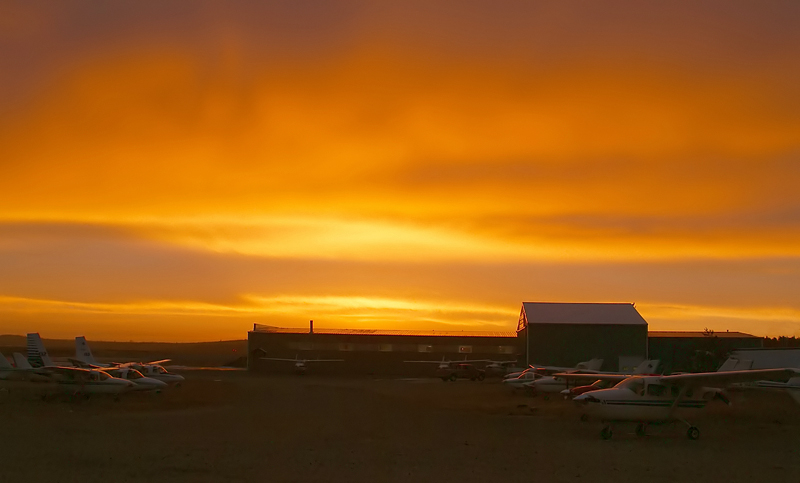 The sun rises over the Dryden Airport.